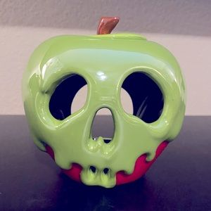 Snow White's poison apple candle holder.